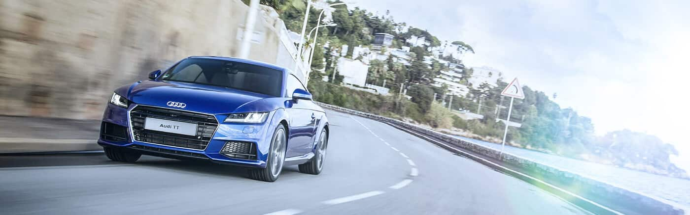 tt_coupe_audi_sport_blue_front_angle_1400x438.jpg